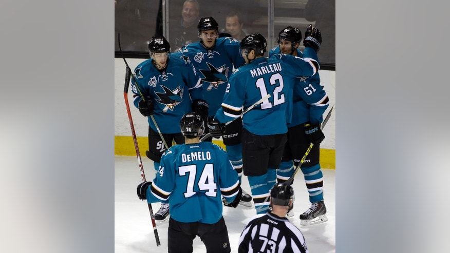 San Jose Sharks' Justin Braun (61) celebrates his goal with teammates during the first period of an NHL hockey game against the Los Angeles Kings Monday, March 28, 2016, in San Jose, Calif. (AP Photo/Marcio Jose Sanchez)