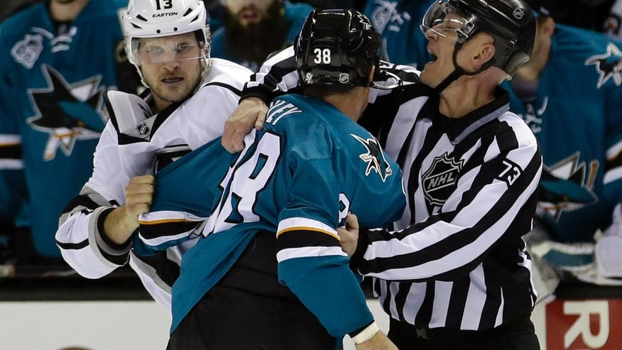 Los Angeles Kings' Kyle Clifford (13) fights with San Jose Sharks' Micheal Haley (38) during the second period of an NHL hockey game Monday, March 28, 2016, in San Jose, Calif. (AP Photo/Marcio Jose Sanchez)