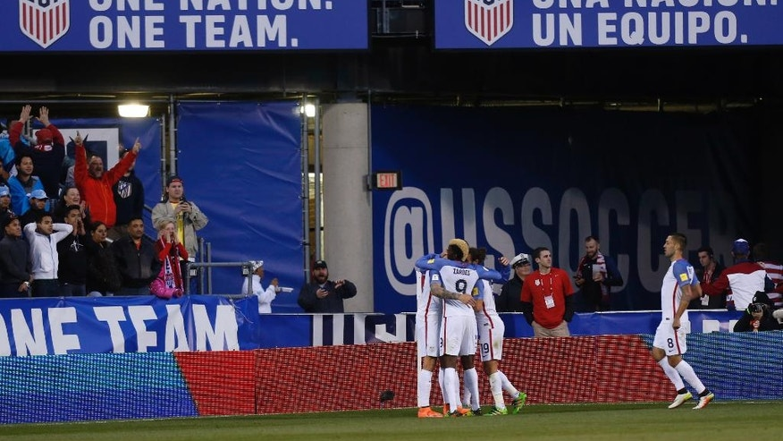 United States players celebrate Geoff Cameron's goal against Guatemala during the first half of a World Cup qualifying soccer match Tuesday, March 29, 2016, in Columbus, Ohio. (AP Photo/Jay LaPrete)