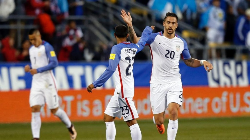 United States' Geoff Cameron, right, celebrates goal against Guatemala with teammate Edgar Castillo during the first half of a World Cup qualifying soccer match Tuesday, March 29, 2016, in Columbus, Ohio. (AP Photo/Jay LaPrete)