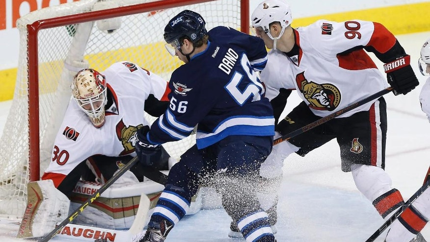 Ottawa Senators goaltender Andrew Hammond (30) makes the save on a shot from Winnipeg Jets' Marko Dano (56) as Senators' Alex Chiasson (90) defends during the first period of an NHL hockey game Tuesday, March 30, 2016, in Winnipeg, Manitoba. (John Woods/The Canadian Press via AP)
