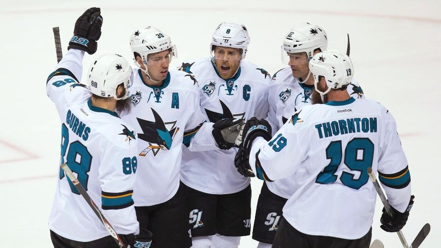 San Jose Sharks' Brent Burns, Logan Couture, Joe Pavelski, Patrick Marleau and Joe Thornton, from left, celebrate Couture's goal against the Vancouver Canucks during the third period of an NHL hockey game Tuesday, March 29, 2016, in Vancouver, British Columbia. (Darryl Dyck/The Canadian Press via AP)