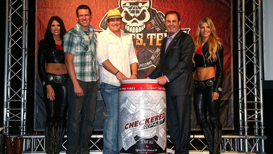 DALLAS, TEXAS - MARCH 30: Texas Motor Speedway President Eddie Gossage and Scott Lindsey, owner of Audacity Brew House in Denton, Texas unveil the new Checkered Past beer during the Texas Motor Speedway Media Day at Gilley's Dallas on March 30, 2016 in Dallas, Texas. (Photo by Sarah Crabill/Getty Images for Texas Motor Speedway)