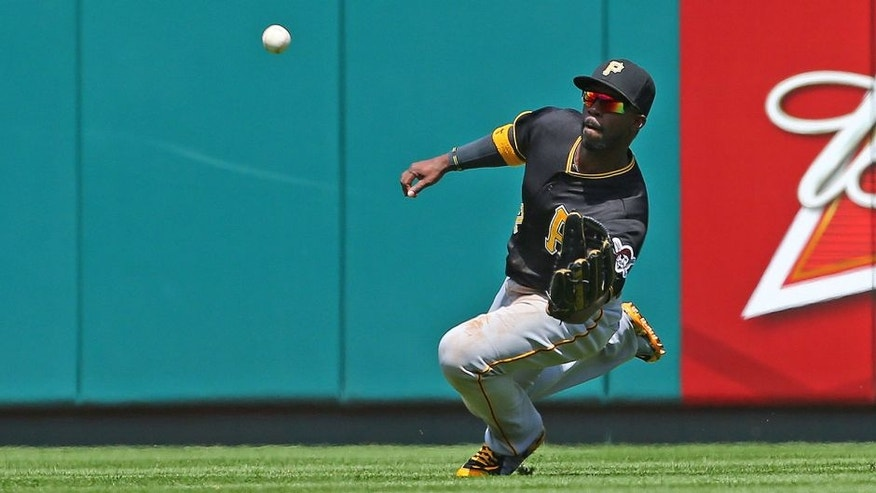 <p>ST. LOUIS, MO - MAY 2: Andrew McCutchen #22 of the Pittsburgh Pirates catches a line drive against the St. Louis Cardinals in the third inning at Busch Stadium on May 2, 2015 in St. Louis, Missouri. (Photo by Dilip Vishwanat/Getty Images)</p>