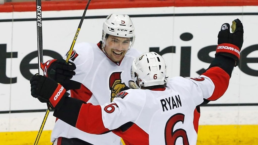 Ottawa Senators' Cody Ceci , left, and Bobby Ryan celebrate Ceci's tie-breaking and decisive goal off Minnesota Wild goalie Devan Dubnyk in the third period of an NHL hockey game Thursday, March 31, 2016, in St. Paul, Minn. The Senators won 3-2. (AP Photo/Jim Mone)