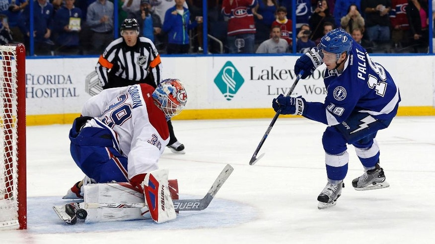 Montreal Canadiens goalie Mike Condon makes a save on a penalty shot by Tampa Bay Lightning's Ondrej Palat, of the Czech Republic, during the second period of an NHL hockey game Thursday, March 31, 2016, in Tampa, Fla. (AP Photo/Mike Carlson)