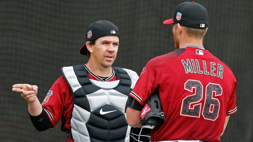 Feb 19, 2016; Scottsdale, AZ, USA; Arizona Diamondbacks catcher Tuffy Gosewisch (8) talks to pitcher Shelby Miller (26) during spring training camp at Salt River Fields. Mandatory Credit: Rick Scuteri-USA TODAY Sports