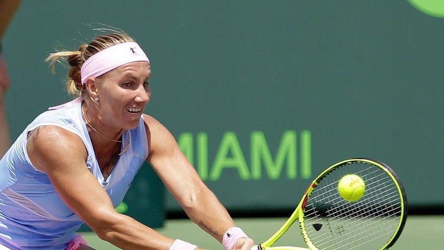 Svetlana Kuznetsova, of Russia, returns to Timea Bacsinszky, of Switzerland, during the Miami Open tennis tournament in Key Biscayne, Fla., Thursday, March 31, 2016. (AP Photo/Alan Diaz)