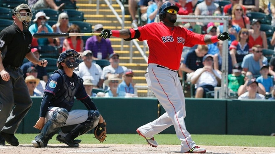 Boston Red Sox's David Ortiz follows through on a swing as he, Minnesota Twins catcher John Ryan Murphy and umpire Junior Valentine watch the flight of Ortiz's home run ball in the fifth inning of a spring training baseball game, Thursday, March 31, 2016, in Fort Myers, Fla. The shot to right came off a pitch from Twins starter Kyle Gibson. (AP Photo/Tony Gutierrez)