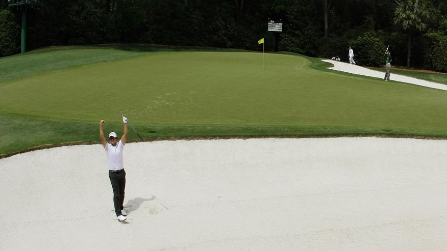 ADVANCE FOR WEEKEND EDITIONS, APRIL 2-3 - In this April 10, 2010, file photo, Adam Scott, of Australia, celebrates after chipping in from a bunker on the fourth hole during the third round of the Masters golf tournament in Augusta, Ga. The longest par 3 at Augusta National is so daunting that Adam Scott said he might consider laying up each day and taking his chances. The 240-yard fourth hole is the only par 3 to yield just one hole-in-one in 79 years of the Masters. (AP Photo/Charlie Riedel)