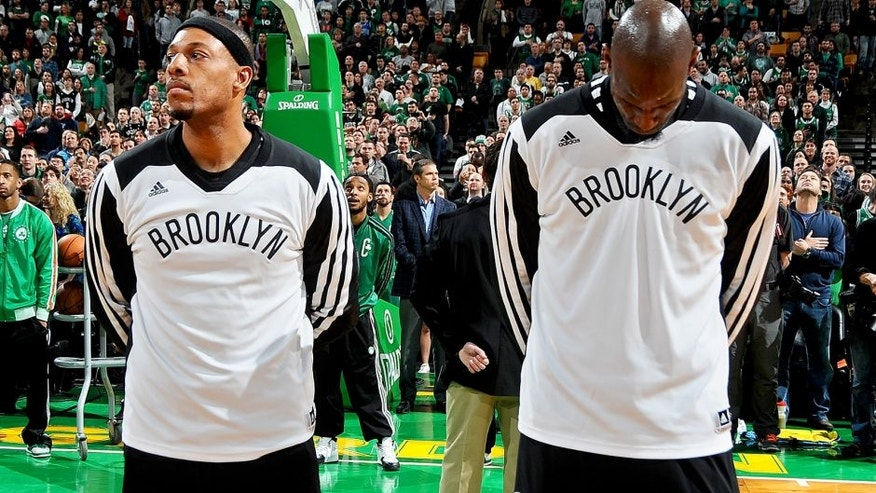 BOSTON, MA - JANUARY 26: Paul Pierce #34 and Kevin Garnett #2 of the Brooklyn Nets stand on the court during the national anthem before the game against the Boston Celtics on January 26, 2014 at the TD Garden in Boston, Massachusetts. NOTE TO USER: User expressly acknowledges and agrees that, by downloading and or using this photograph, User is consenting to the terms and conditions of the Getty Images License Agreement. Mandatory Copyright Notice: Copyright 2014 NBAE (Photo by Steve Babineau/NBAE via Getty Images)