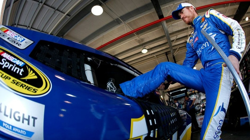 FONTANA, CA - MARCH 19: Brian Vickers, driver of the #14 Janssen Arnie's Army Charitable Foundation Chevrolet, gets into his car during practice for the NASCAR Sprint Cup Series Auto Club 400 at Auto Club Speedway on March 19, 2016 in Fontana, California. (Photo by Jonathan Ferrey/Getty Images)