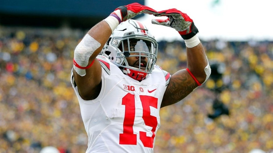 Nov 28, 2015; Ann Arbor, MI, USA; Ohio State Buckeyes running back Ezekiel Elliott (15) celebrates a touchdown in the first quarter against the Michigan Wolverines at Michigan Stadium. Mandatory Credit: Rick Osentoski-USA TODAY Sports