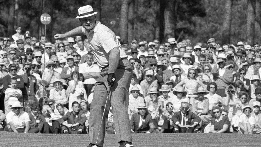 ADVANCE FOR WEEKEND EDITIONS, APRIL 2-3 - FILE - In this April 11, 1966, file photo, Golfer Jack Nicklaus cheers along his ball as it drops for a birdie on sixth green during a playoff in the Masters golf tournament at Augusta's National Golf Club in Augusta, Ga. One year after he set the 72-hole record at 271 to beat Arnold Palmer and Gary Player by nine shots, he finished at even-par 288, and won in what was the first three-man playoff at the tournament. (AP Photo/File)
