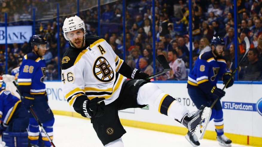 Boston Bruins' David Krejci, of the Czech Republic, celebrates after scoring a goal during the first period of an NHL hockey game against the St. Louis Blues, Friday, April 1, 2016, in St. Louis. (AP Photo/Billy Hurst)