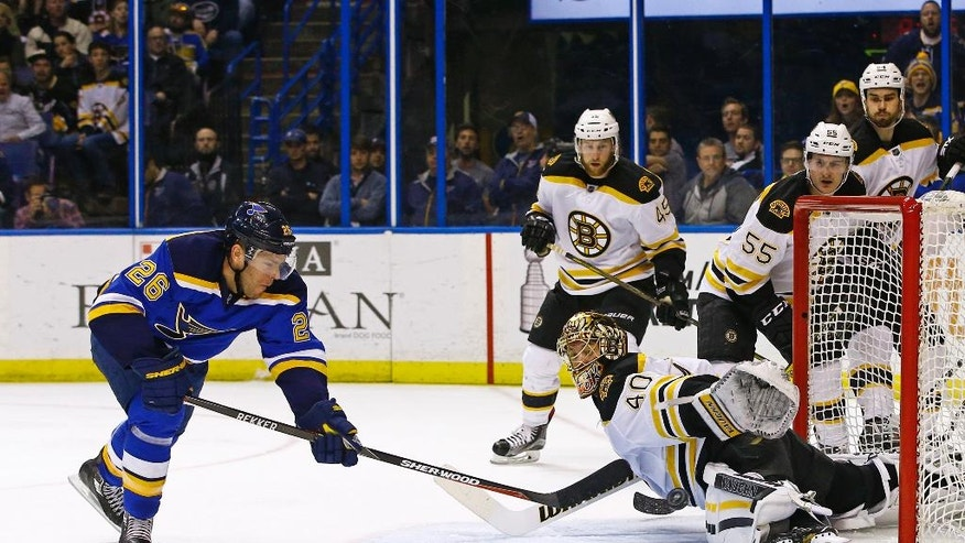St. Louis Blues' Paul Stastny, left, scores a goal past the outstretched glove of Boston Bruins goalie Tuukka Rask, of Finland, during the second period of an NHL hockey game Friday, April 1, 2016, in St. Louis. (AP Photo/Billy Hurst)