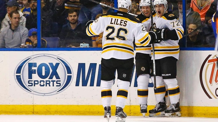 Boston Bruins' Frank Vatrano (72) is congratulated by teammates Lee Stempniak  (20) and John-Michael Liles (26) after scoring a goal during the second period of an NHL hockey game against the St. Louis Blues, Friday, April 1, 2016, in St. Louis. (AP Photo/Billy Hurst)