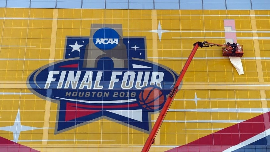 Mar 28, 2016; Houston, TX, USA; A worker applies signage to the side of NRG Stadium in preparations for the 2016 NCAA Men's Final Four Championship. Mandatory Credit: Bob Deutsch-USA TODAY Sports