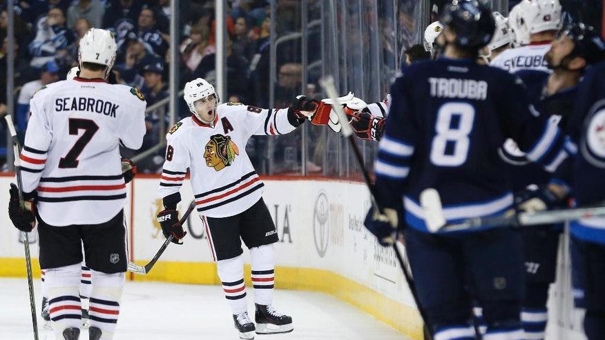 Chicago Blackhawks' Patrick Kane (88) celebrates his goal against the Winnipeg Jets during the second period of an NHL hockey game Friday, April 1, 2016, in Winnipeg, Manitoba. (John Woods/The Canadian Press via AP)