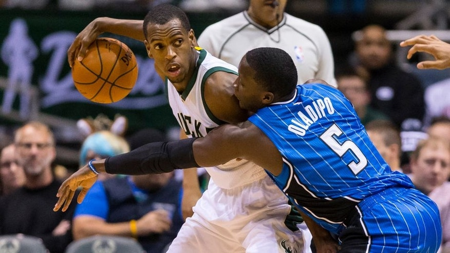 Jan 26, 2016; Milwaukee, WI, USA; Orlando Magic guard Victor Oladipo (5) defends Milwaukee Bucks guard Khris Middleton (22) during the first quarter at BMO Harris Bradley Center. Mandatory Credit: Jeff Hanisch-USA TODAY Sports