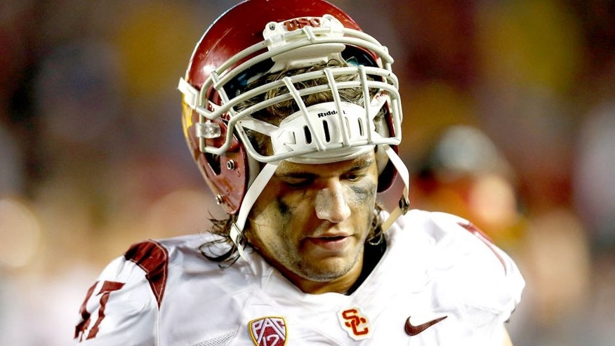 Sep 13, 2014; Boston, MA, USA; Southern California Trojans line backer Scott Felix (47) on the sideline dejected during the fourth quarter against the Boston College Eagles at Alumni Stadium. The Boston College Eagles won 37-31. Mandatory Credit: Greg M. Cooper-USA TODAY Sports