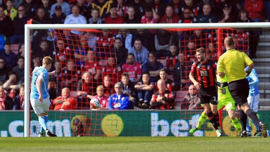 Manchester City's Kevin De Bruyne, left, scores his side's second goal during their English Premier League match against Bournemouth at the Vitality Stadium, Bournemouth, England, Saturday, April 2, 2016. (Adam Davy/PA via AP)     UNITED KINGDOM OUT      -    NO SALES      -       NO ARCHIVES