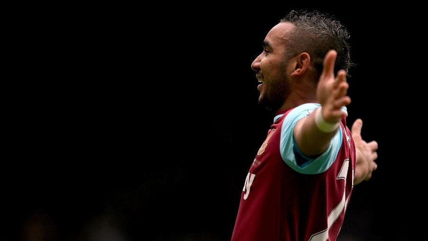 West Ham United's Dimitri Payet celebrates scoring his side's second goal of the game, during the English Premier League soccer match between West Ham United and Crystal Palace at Upton Park, in London, Saturday April 2, 2016. (Steve Paston/PA via AP) UNITED KINGDOM OUT