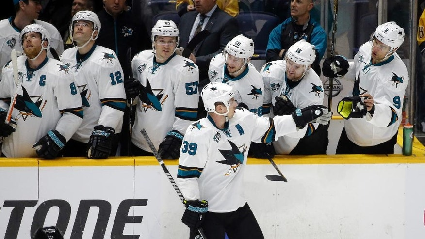 San Jose Sharks center Logan Couture (39) celebrates with teammates after he scored against the Nashville Predators during a shootout at an NHL hockey game Saturday, April 2, 2016, in Nashville, Tenn. Couture's goal gave the Sharks a 3-2 win. (AP Photo/Mark Humphrey)