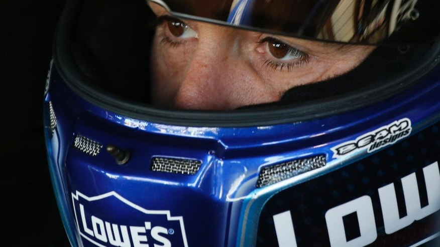 Driver Jimmie Johnson gets ready for the final practice for Sunday's NASCAR Sprint Cup Series auto raceat the Martinsville Speedway Saturday, April 2, 2016 in Martinsville, Va. (AP Photo/Steve Helber)