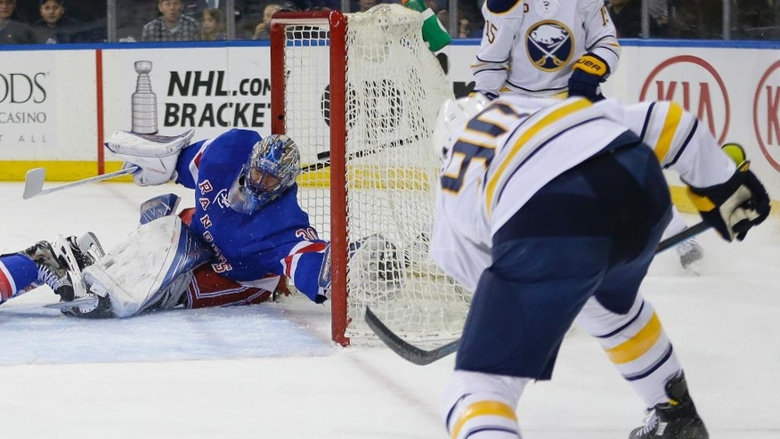 Buffalo Sabres' Ryan O'Reilly (90) shoots the puck past New York Rangers goalie Henrik Lundqvist (30), of Sweden, for a goal during the first period of an NHL hockey game Saturday, April 2, 2016, in New York. (AP Photo/Frank Franklin II)