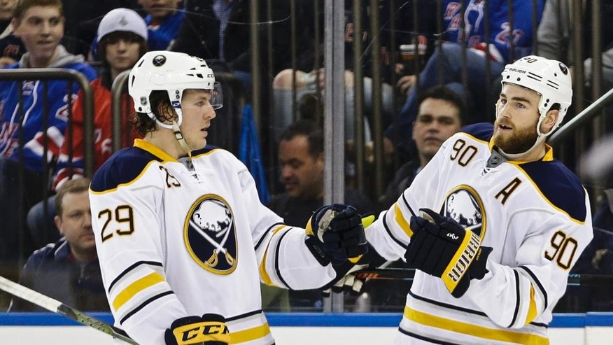 Buffalo Sabres' Jake McCabe (29) and Ryan O'Reilly (90) celebrate a goal by O'Reilly during the first period of an NHL hockey game against the New York Rangers on Saturday, April 2, 2016, in New York. (AP Photo/Frank Franklin II)