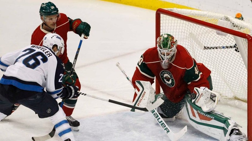Tuesday, Nov. 10: Minnesota Wild goalie Devan Dubnyk deflects a shot by Winnipeg Jets right wing Blake Wheeler in front of Wild defenseman Nate Prosser during the first period in St. Paul, Minn.