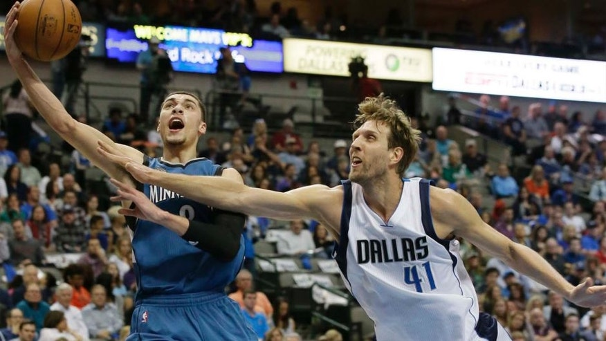 Minnesota Timberwolves guard Zach LaVine drives against Dallas Mavericks forward Dirk Nowitzki during the first half Sunday, Feb. 28, 2016, in Dallas.