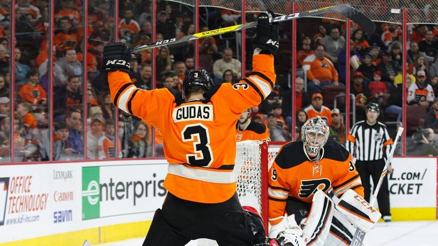 Ottawa Senators' Bobby Ryan (6) looks on after slipping on the ice as Philadelphia Flyers' Radko Gudas (3), of Czech Republic, holds his stick in the air with Steve Mason (35) watching during the third period of an NHL hockey game, Saturday, April 2, 2016, in Philadelphia. The Flyers won 3-2. (AP Photo/Chris Szagola)