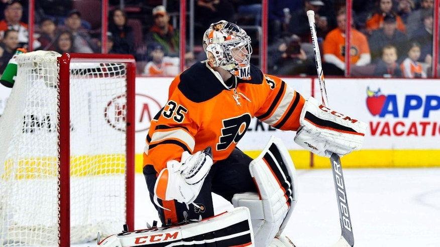 Philadelphia Flyers' Steve Mason (35) looks up after picking up the puck during the first period of an NHL hockey game against the Ottawa Senators, Saturday, April 2, 2016, in Philadelphia. (AP Photo/Chris Szagola)