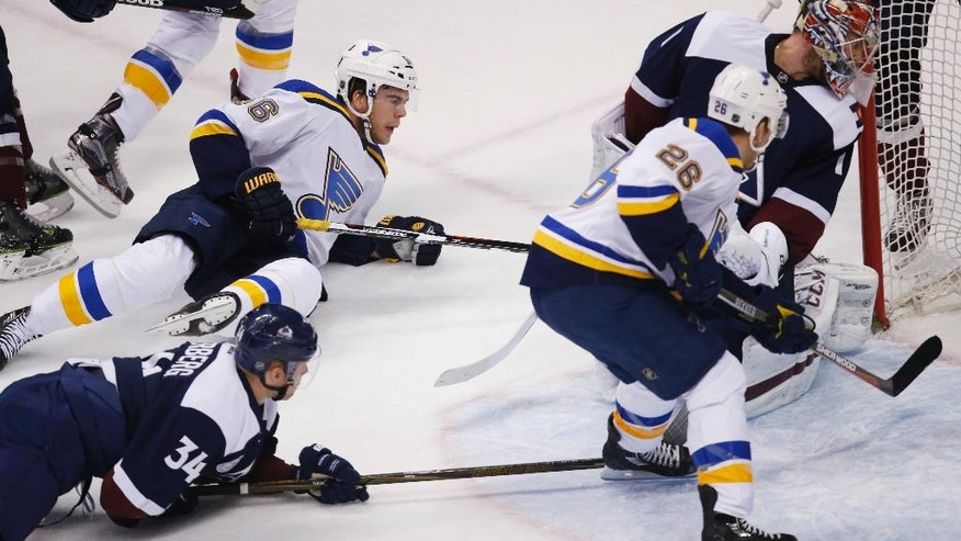 St. Louis Blues left wing Magnus Paajarvi, top left, of Sweden, scores a goal past Colorado Avalanche goalie Semyon Varlamov, top right, of Russia, as Avalanche center Carl Soderberg, front left, of Sweden, and Blues center Paul Stastny look on in the first period of an NHL hockey game, Sunday, April 3, 2016, in Denver. (AP Photo/David Zalubowski)