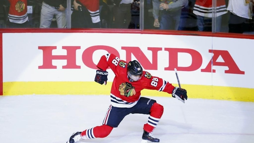 Chicago Blackhawks right wing Patrick Kane (88) celebrates his goal against the Boston Bruins during the first period of an NHL hockey game Sunday, April 3, 2016, in Chicago. (AP Photo/Jeff Haynes)