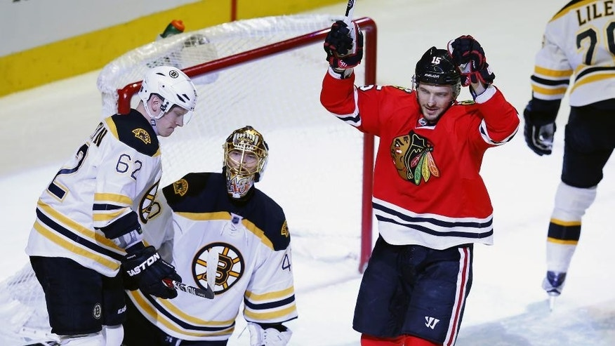 Chicago Blackhawks center Artem Anisimov (15) celebrates a goal past Boston Bruins goalie Tuukka Rask (40) during the first period of an NHL hockey game Sunday, April 3, 2016, in Chicago. (AP Photo/Jeff Haynes)