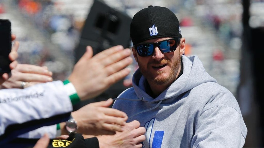 Driver Dale Earnhardt Jr. greets fans during driver introductions for the Sprint Cup auto race at Martinsville Speedway on Sunday, April 3, 2016, in Martinsville, Va. (AP Photo/Steve Helber)