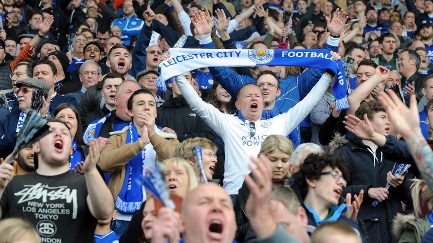 Leicester fans celebrate during the English Premier League soccer match between Leicester City and Southampton at the King Power Stadium in Leicester, England, Sunday, April 3, 2016. (AP Photo/Rui Vieira)