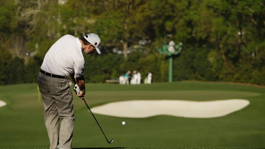 ADVANCE FOR WEEKEND EDITIONS, APRIL 2-3 - In this photo taken April 9, 2013, Paul Lawrie, of Scotland, tees off at the fourth hole during a practice round for the Masters golf tournament  in Augusta, Ga. The 240-yard fourth hole is the only par 3 to yield just one hole-in-one in 79 years of the Masters. That was by Jeff Sluman in 1992. (AP Photo/Charlie Riedel, File)