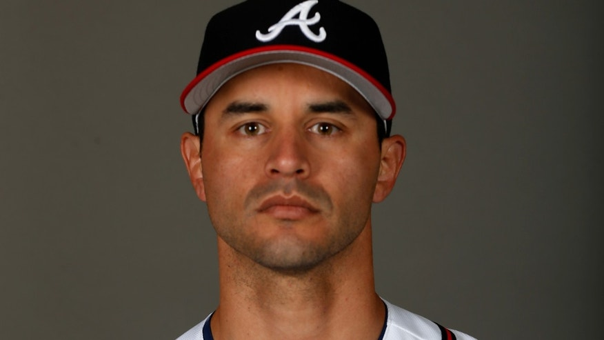 LAKE BUENA VISTA, FL - FEBRUARY 26:  Carlos Torres #17 of the Atlanta Braves  poses on photo day at Champion Stadium on February 26, 2016 in Lake Buena Vista, Florida.  (Photo by Rob Carr/Getty Images)
