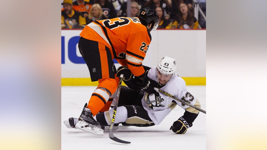 Philadelphia Flyers' Brandon Manning (23) tries to keep down Pittsburgh Penguins' Conor Sheary (43) in the second period of an NHL hockey game, Sunday, April 3, 2016, in Pittsburgh. (AP Photo/Keith Srakocic)