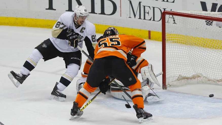 Pittsburgh Penguins' Sidney Crosby (87) scores past Philadelphia Flyers' Nick Schultz (55) and goalie Steve Mason in the first period of an NHL hockey game, Sunday, April 3, 2016, in Pittsburgh. (AP Photo/Keith Srakocic)