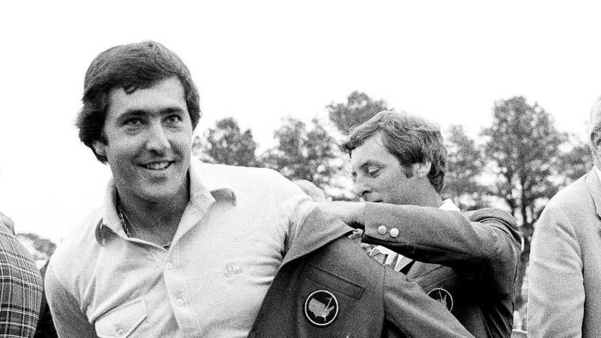 FILE - In this April 13, 1980 file photo, Seve Ballesteros of Spain, left, is helped with his Masters green jacket by the previous year's winner, Fuzzy Zoeller, right, after winning the 1980 Masters, in Augusta, Ga. Ballesteros had a 10-shot lead going to the back nine in the 1980 Masters before throwing away shots. His six-shot win was one of the most dominant Masters victories. (AP Photo/file)