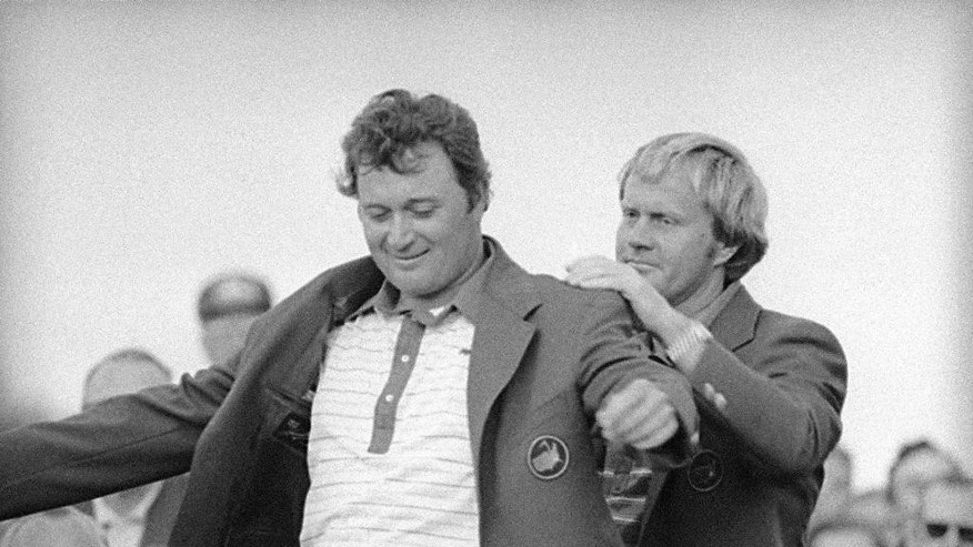 FILE - In this April 12, 1976 file photo, Jack Nicklaus, right, assists Raymond Floyd in putting on his green jacket after Floyd won the Masters Championship at Augusta, Ga. Floyd won wire-to-wire for an eight-shot victory over Ben Crenshaw. He was the last wire-to-wire winner at the Masters until Jordan Spieth in 2015. (AP Photo/file)