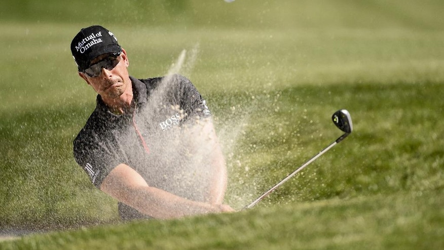 Henrik Stenson blasts out of a bunker on the 14th hole during the final round of the Houston Open golf tournament, Sunday, April 3, 2016, in Humble, Texas. (AP Photo/Eric Christian Smith)