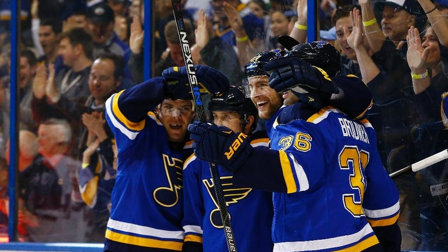 St. Louis Blues' Alex Pietrangelo, third from left, celebrates with teammates Paul Stastny, left, Jaden Schwartz Troy Brouwer after scoring a goal during the second period of an NHL hockey game against the Arizona Coyotes, Monday, April 4, 2016, in St. Louis. (AP Photo/Billy Hurst)