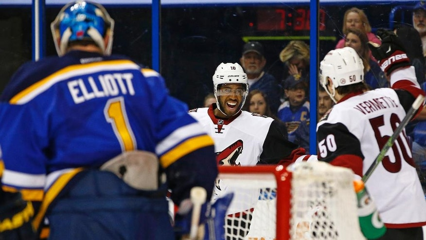 Arizona Coyotes' Anthony Duclair, middle, celebrates with Antoine Vermette after scoring a goal against St. Louis Blues goalie Brian Elliott during the first period of an NHL hockey game Monday, April 4, 2016, in St. Louis. (AP Photo/Billy Hurst)