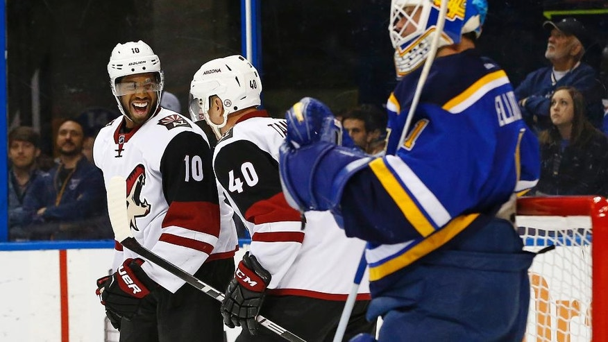 Arizona Coyotes' Anthony Duclair, left, celebrates with Alex Tanguay after scoring a goal against St. Louis Blues goalie Brian Elliott during the first period of an NHL hockey game Monday, April 4, 2016, in St. Louis. (AP Photo/Billy Hurst)